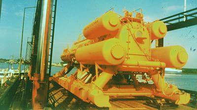 bright yellow structure on a ship ready to be lowered into the water