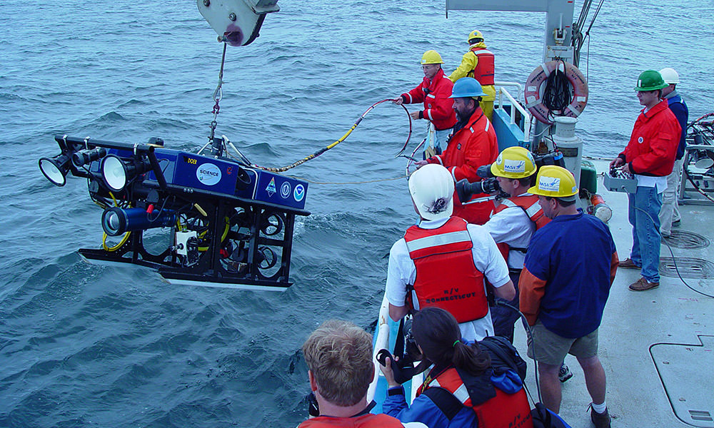 rov being deployed off of a ship